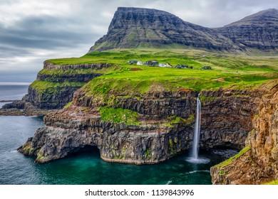 Gasadalur village and Beautiful  waterfall, Vagar, Faroe Islands, Denmark.