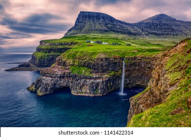 Gasadalur village and Beautiful  waterfall, Vagar, Faroe Islands, Denmark.