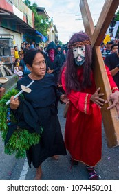 GASAN , PHILIPPINES - MARCH 30 : Participants in a Good Friday procession in Gasan, Marinduque Island, The Philippines on March 30 2018