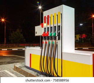 Gasoline column for refueling. Five gasoline pump nozzles at petrol station. Refueling pistols in column.
