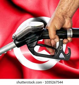 Gasoline consumption concept - Hand holding hose against flag of Tunisia