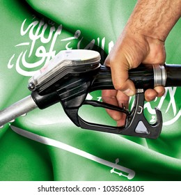 Gasoline consumption concept - Hand holding hose against flag of Saudi Arabia
