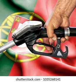 Gasoline consumption concept - Hand holding hose against flag of Portugal