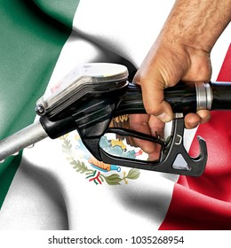Gasoline consumption concept - Hand holding hose against flag of Mexico