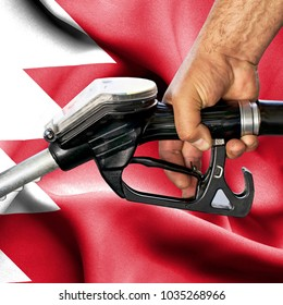 Gasoline consumption concept - Hand holding hose against flag of Bahrain