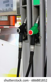Gasoline and diesel fuel pump nozzles at the gas station. Source of energy for transport