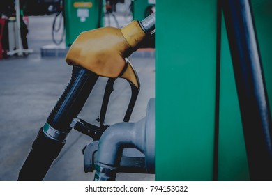 Gasoline distributor at the gas station. Gas pump nozzles.