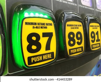 Gasoline octane selection buttons at a typical self service gas station. Regular unleaded 87 octane fuel selected.