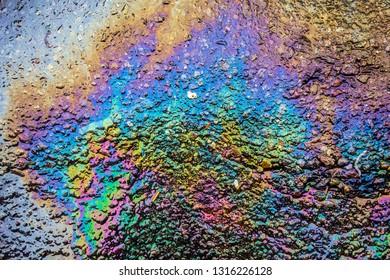 Gasoline Petrol Rainbow Oil Spill on Tarmac Road