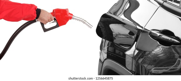 Gasoline pistol pump gun fuel nozzle and car on gas station