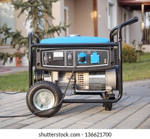 Gasoline powered portable generator at home.