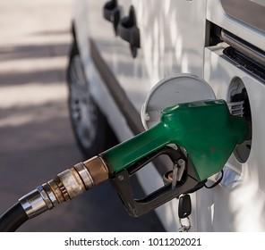Gasoline Pump Noose in fuel tank of car.