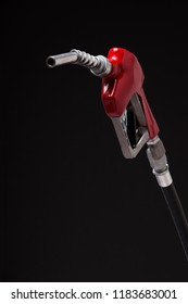 A gasoline pump nozzle with a red vinyl covered handle isolated on black