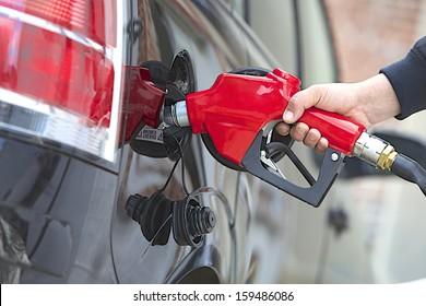 Gasoline pump refilling automobil fuel. Shallow focus.