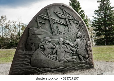 Gaspe, Quebec, Canada - September 18, 2009 : cast iron sculptures symbolize the scenes of the historic encounter between Jacques Cartier  and Iroquois in July 1534
