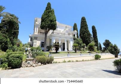 Gastouri, Corfu, Greece – July 6, 2017: Tourists visit the Achilleion Palace on a sunny day.