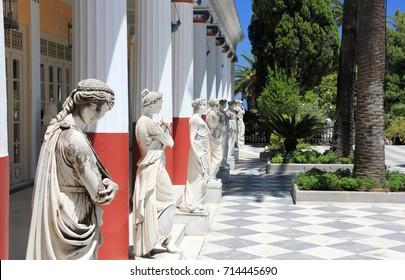 Gastouri, Corfu, Greece – July 6, 2017: Statues in the Achilleion terrace. Tourists visit the Achilleion Palace on a sunny day.