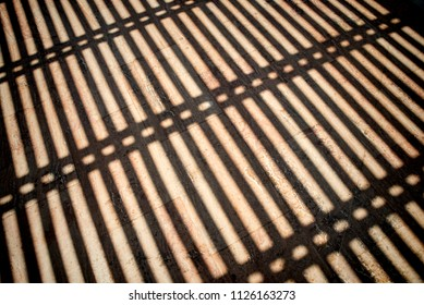 Gate bars as a shadow pattern