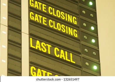 gate closing and last call message on airport information board.