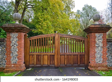 Gate and Driveway of a Country Mansion