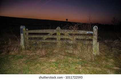 Gate to the dyke in the sunset