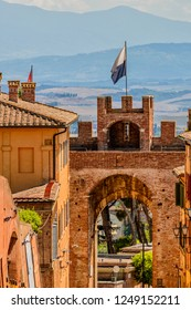 A gate to enter in the old part of city of Siena, Toscany, Italy