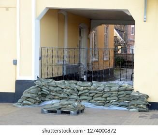 A gate has been blocked with sandbags due to an approaching storm surge.