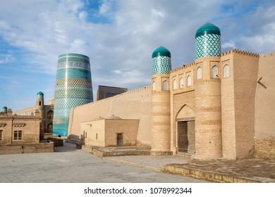 Gate of Kunya-Ark citadel and Kalta Minor minaret in Khiva, Khorezm Region, Uzbekistan