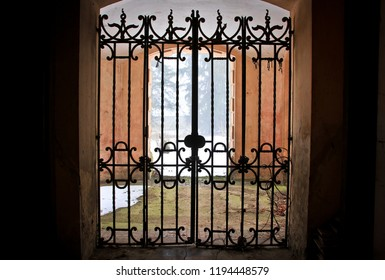 Gate with lattice in an abandoned castle in the Czech Republic