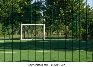Gate on an artificial mini-football field. Shooting through the fence.