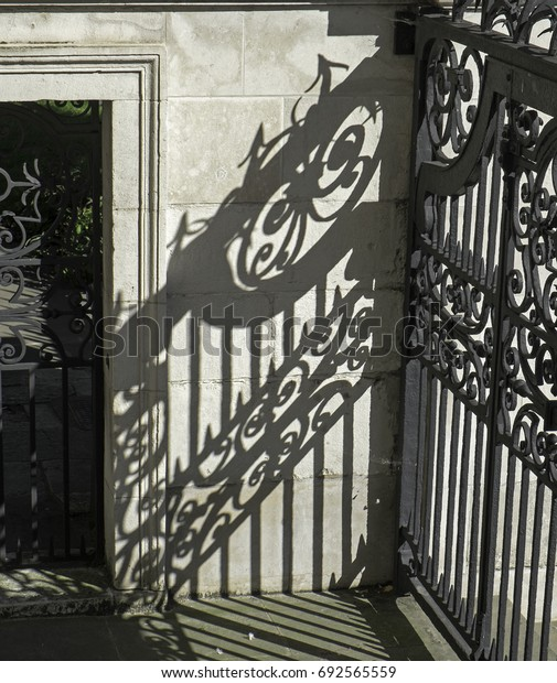 gate and its shadow