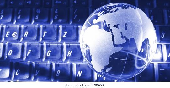gate to the world - glassglobe on a keyboard