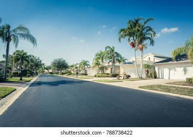 Gated community houses and empty asphalt road,  South Florida, United States
