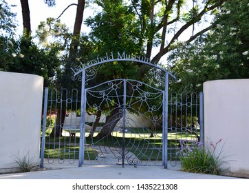 Gated entrance to Bakersfield Art Museum, June 26, 2019.