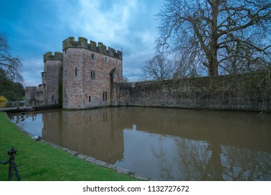 Gatehouse and moat at the gateway to the Bishop's Palace in Wells, Somerset, UK