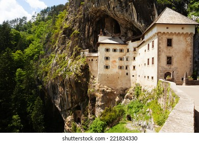 Gates of Predjama castle, build inside the mountain in Slovenia