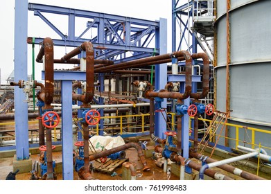 Gates, rusted pipe fittings in petrochemical production. Repair at an oil refinery.