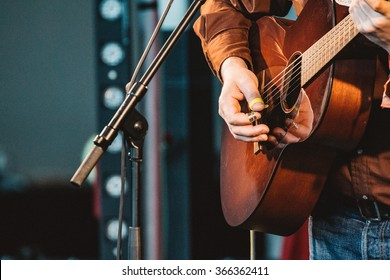 GATESHEAD, ENGLAND - JANUARY 22 2015: Norrie McCulloch performs live on the indoor stage at Sage Gateshead's Summertyne Americana Festival 2015