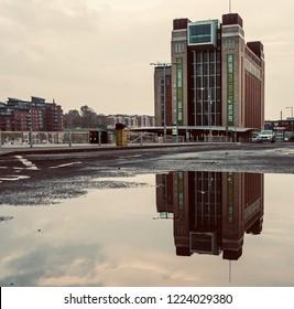 Gateshead, England. November 6, 2018. Puddle reflection of the Baltic Centre for Contemporary Arts on Gateshead quayside.