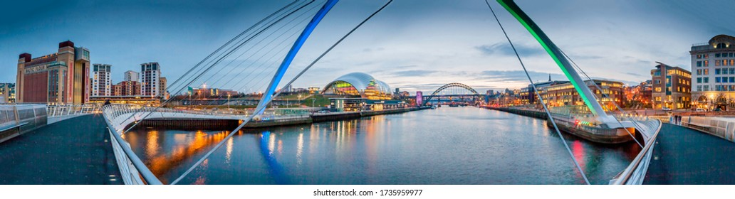 The Gateshead Millennium Bridge is a pedestrian and cyclist tilt bridge spanning the River Tyne in England linking Gateshead's Quays & Newcastle Quayside: NE England, UK, February 29 2016
