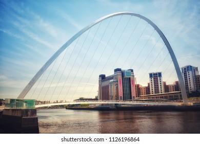 Gateshead millennium bridge and quayside over the River Tyne.