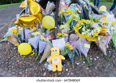 GATESHEAD, UK - 26TH MAY 2017: Flowers laid upon the feet of the Angel of the North in memory of Courtney Boyle,  and step dad Philip Tron, who died in the Manchester terror attack.