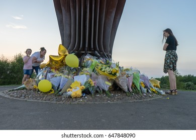 GATESHEAD, UK - 26TH MAY 2017: Flowers laid upon feet of the Angel of the North in memory of Courtney Boyle,  and step dad Philip Tron, who died in the Manchester terror attack. People paying respect