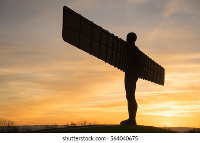 GATESHEAD, UK - JANUARY 5th, 2017. The Angel of the North, Gateshead. A steel sculpture by Antony Gormley, stands 66 feet high with a wing span of 177 feet. The sky is blue.