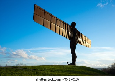 GATESHEAD, UK - MARCH 27, 2016. The Angel of the North, Gateshead. A steel sculpture by Antony Gormley, stands 66 feet high with a wing span of 177 feet. The sky is blue.