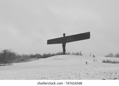 GATESHEAD, UK - NOVEMBER 30, 2017. The Angel of the North, Gateshead. A steel sculpture by Antony Gormley, stands 66 feet high with a wing span of 177 feet. The ground is covered in snow.
