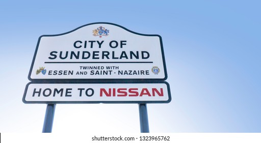 Gateshead, United Kingdom - February 26th 2019: City of Sunderland Road Sign, Twinned with Essen and Saint - Nazaire.  Sign below mentions Home to Nissan.  Reflective white road sign with black text.