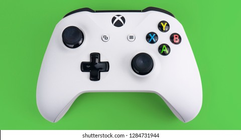 Gateshead, United Kingdom - January 15th 2019: Xbox One S White Controller featured on Green Background