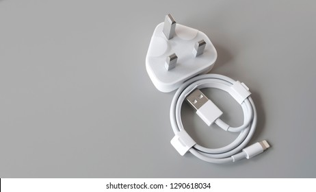 Gateshead, United Kingdom - January 21st 2019: Apple Lightning Charging Cable, not opened and still in packaging - featured on a grey background