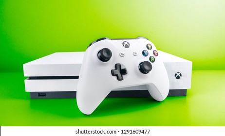 Gateshead, United Kingdom - January 22nd 2019: Xbox One S Console and White Xbox One Controller at front featured on a dynamically graduated green background making the Xbox One S stand out.